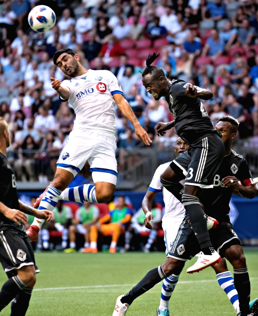 VANCOUVER, July 26, 2018 - Victor Cabrera (top L) of Montreal Impact and Kei Kamara (top R) of Vancouver Whitecaps FC compete for the ball during the semifinal matches of the Canadian Championship at ...