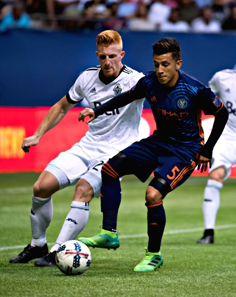VANCOUVER, July 6, 2017 - Vancouver Whitecap's Tim Parker (L) vies with New York FC's Mikey Lopez during an MLS soccer match at BC Place Stadium in Vancouver, Canada, on July 5, 2017.