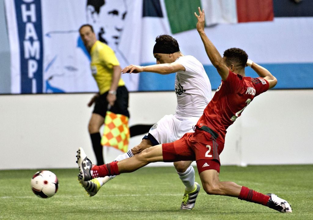 VANCOUVER, June 30, 2016 - Justin Morrow (R) of Toronto FC vies with David Bolano of Vancouver Whitecaps during their second leg of the Canadian Championship soccer final at BC Place, Vancouver, ...
