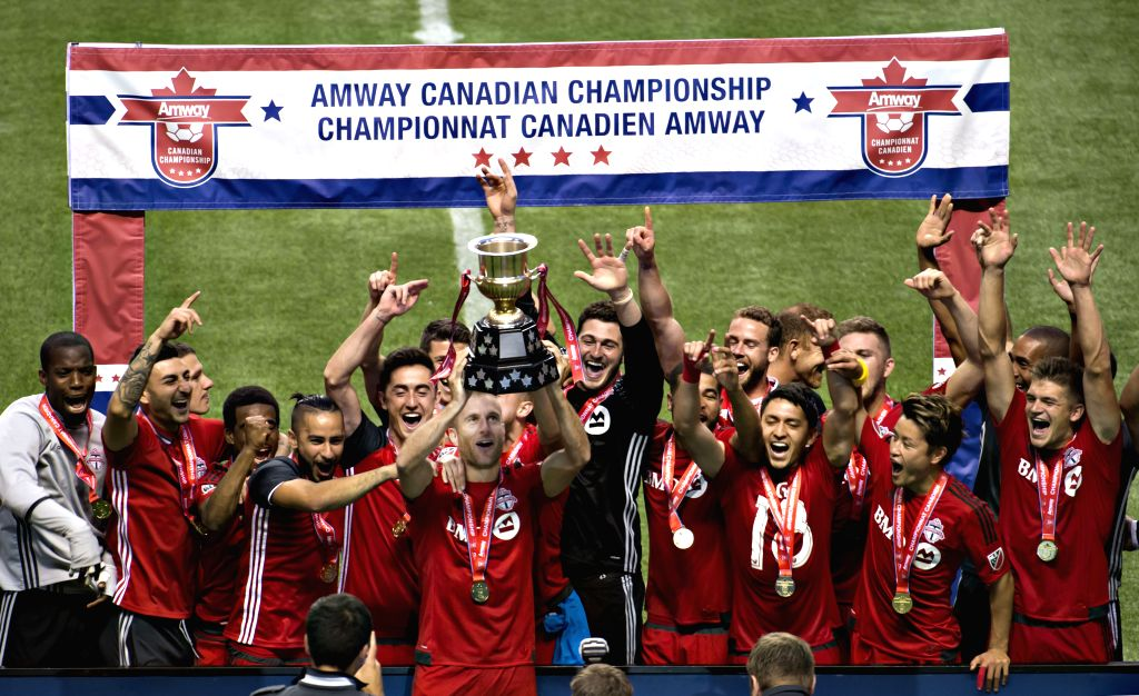 VANCOUVER, June 30, 2016 - Players of Toronto FC celebrate with the trophy during the awarding ceremony for the Canadian Championship soccer final at BC Place, Vancouver, Canada, on June 29, 2016. ...