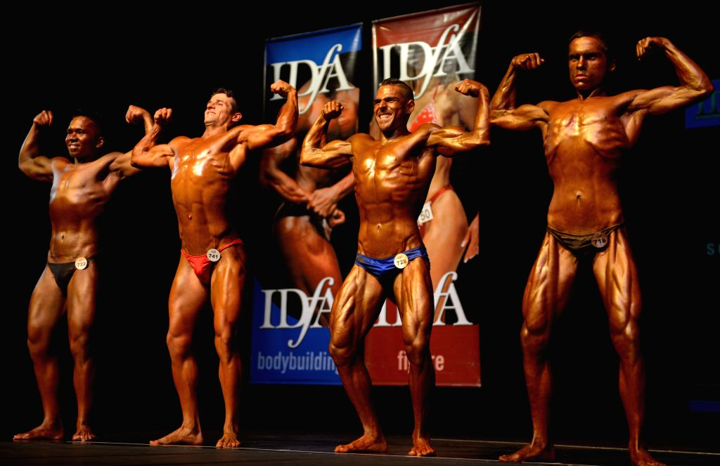 Male athletes compete during the 2014 International Drug Free West Coast Classic Bodybuilding competition in North Vancouver, BC, Canada, Nov. 23, 2014. International Drug Free Athletics ..