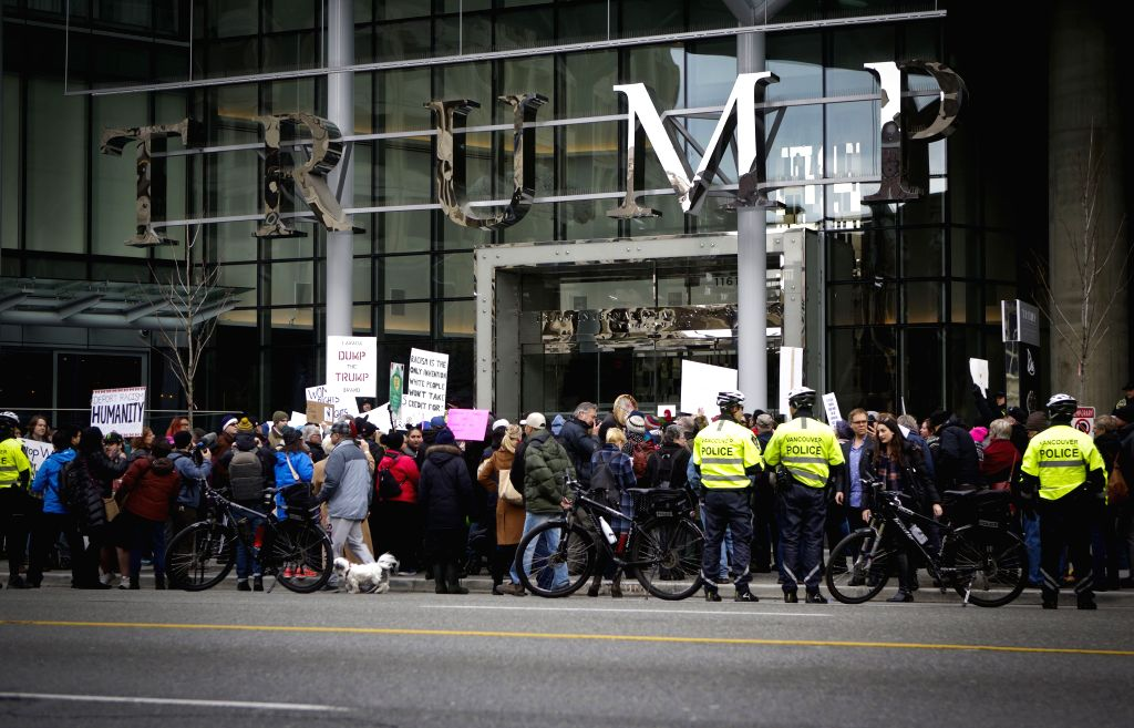 VANCOUVER, March 1, 2017 (Xinhua) -- People protest outside the Trump International Hotel and Tower in Canada's Vancouver on Feb. 28, 2017, the building's official opening day. (Xinhua/Liang Sen/IANS)