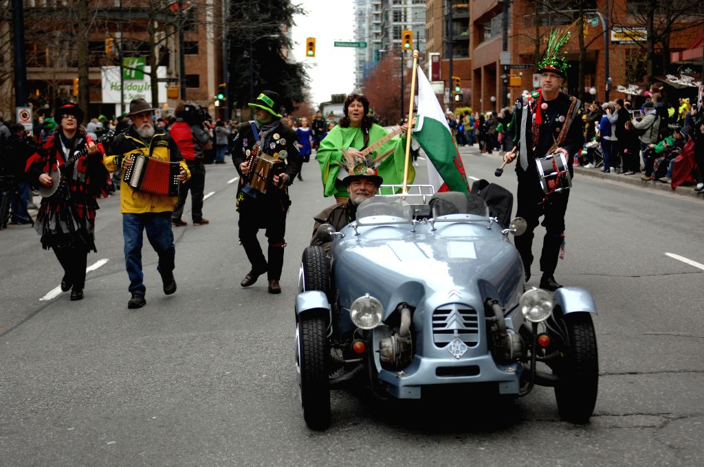 People take part in the annual St. Patrick's Day Parade in Vancouver, Canada, March 15, 2015.