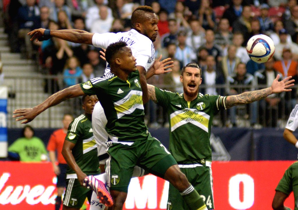 Vancouver Whitecaps' Kendall Waston (top) vies with Portland Timbers' Alvas Powell during their MLS soccer game at BC Place in Vancouver, Canada, on March 28, ...