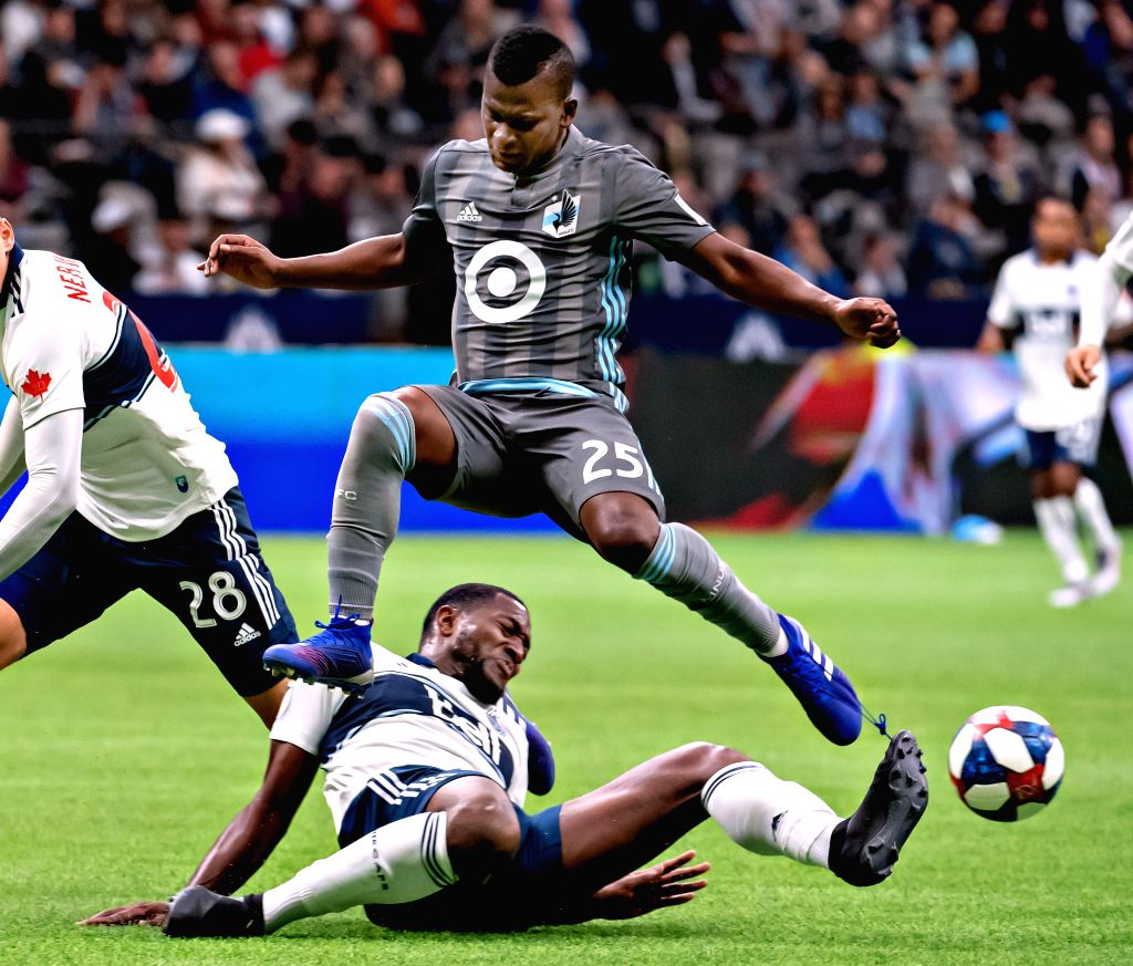 VANCOUVER, March 3, 2019 - Minnesota United FC's Darwin Quintero (top) vies with Vancouver Whitecaps' Doneil Henry during the MLS soccer match between Vancouver Whitecaps and Minnesota United FC in ...