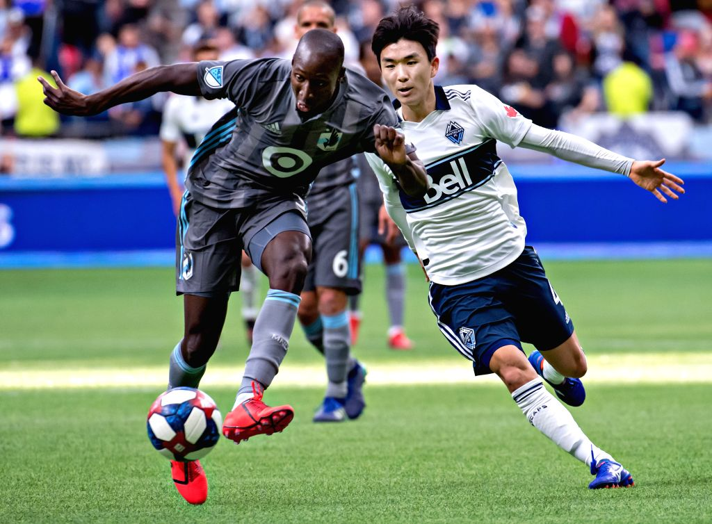 VANCOUVER, March 3, 2019 - Minnesota United FC's Ike Opara (L) vies with Vancouver Whitecaps' Hwang In-Beom during the MLS soccer match between Vancouver Whitecaps and Minnesota United FC in ...