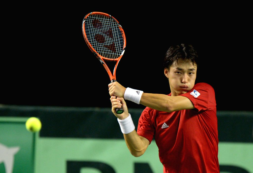 Japan's Go Soeda returns the ball to Canada's Vasek Pospisil during a match at the Davis Cup tennis tournament in Vancouver, Canada, March 8, 2015. Pospisil ...