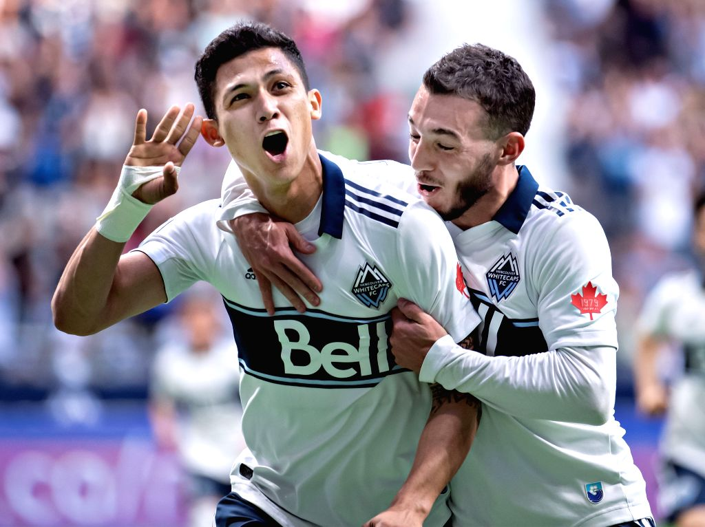 VANCOUVER, May 11, 2019 - Whitecaps' Fredy Montero (L) celebrates scoring with teammate Russell Teibert during a 2019 Major League Soccer (MLS) regular season match between Vancouver Whitecaps and ...