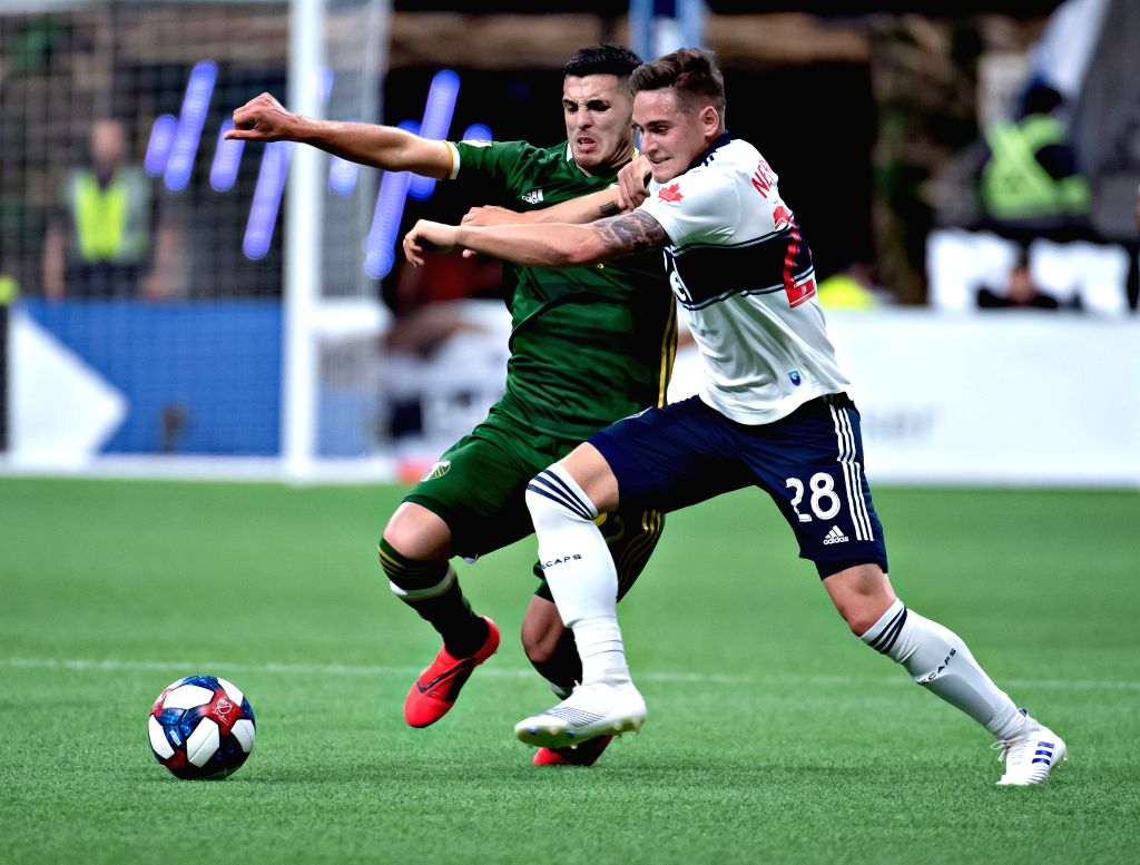 VANCOUVER, May 11, 2019 - Whitecaps' Jakob Nerwinski (R) vies with Timbers' Cristhian Paredes during a 2019 Major League Soccer (MLS) regular season match between Vancouver Whitecaps and Portland ...