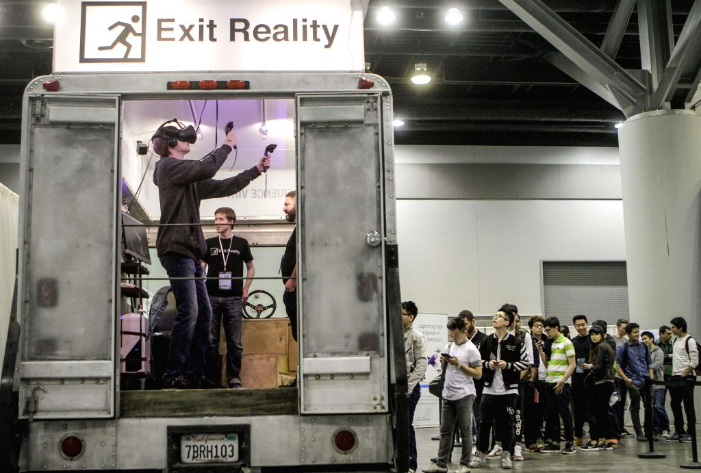 VANCOUVER, May 7, 2017 - Visitors line up at a booth for testing the virtual reality (VR) game during the second annual Consumer Virtual Reality Expo at Vancouver Convention Centre in Vancouver, ...