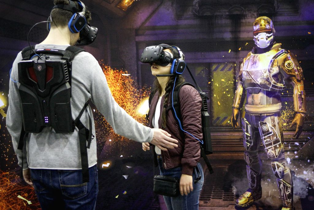 VANCOUVER, May 7, 2017 - Visitors tries out the virtual reality (VR) devices during the second annual Consumer Virtual Reality Expo at Vancouver Convention Centre in Vancouver, Canada, May, 6, 2017. ...