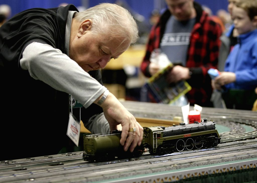 VANCOUVER, Nov. 10, 2019 - A train enthusiast makes adjustment to his mini train during the 37th Vancouver Train Expo in Vancouver, Canada, Nov. 9, 2019. The two-day event showcased railroading ...