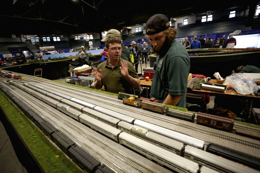 VANCOUVER, Nov. 10, 2019 - Train enthusiasts discuss on the mini rail train setup at the 37th Vancouver Train Expo in Vancouver, Canada, Nov. 9, 2019. The two-day event showcased railroading models ...