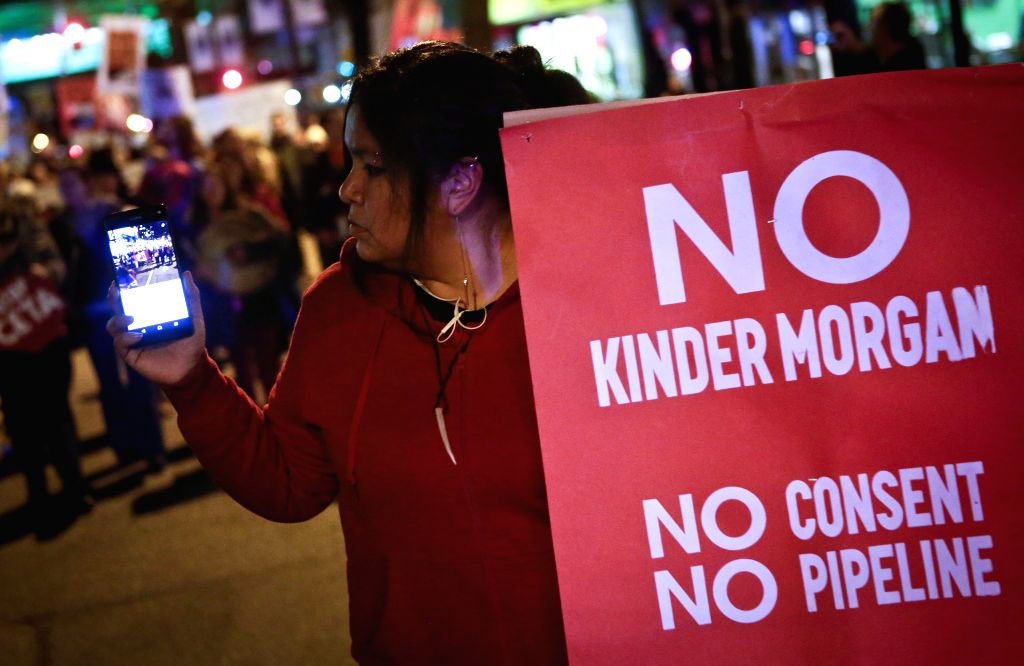 VANCOUVER, Nov. 30, 2016 - A protestor attends a rally protesting against the approval of Kinder Morgan pipeline expansion in Vancouver, Canada, Nov. 29, 2016.