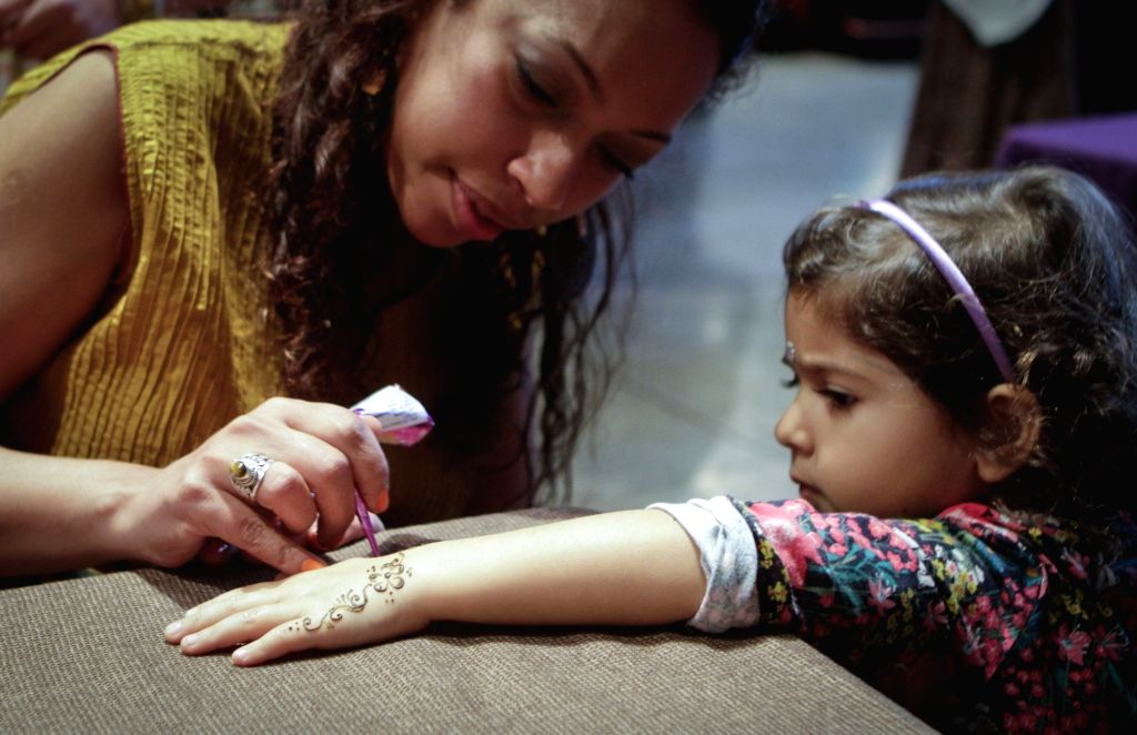VANCOUVER, Oct. 30, 2016 - An artist draws an Indian Henna on a girl's hand during the Diwali festival event in Vancouver, Canada, Oct. 29, 2016. Diwali, or the festival of lights, will be celebrated ...