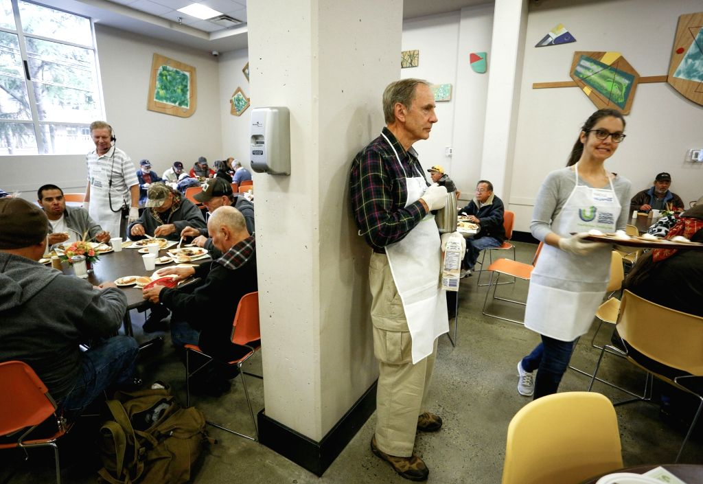 VANCOUVER, Oct. 9, 2017 - Volunteers serve people during the free Thanksgiving meals event in Vancouver, Canada, on Oct. 9, 2017. The event served more than 3,000 free meals to homeless people and ...