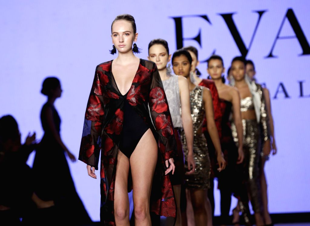 VANCOUVER, Oct. 9, 2019 - Models present creations by designer Davide Grillo during the Vancouver Fashion Week in Vancouver, Canada, Oct. 8, 2019.