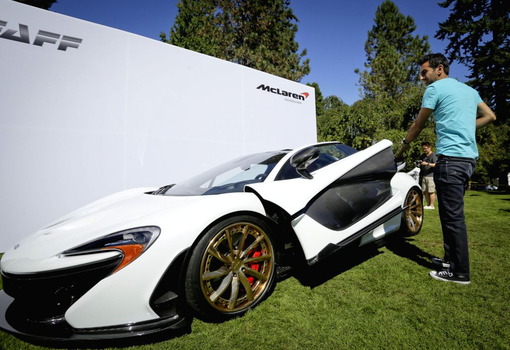 A McLaren P1 super car displays during the Vancouver luxury and super car show at VanDusen Botanical Garden in Vancouver , Canada, Sept. 5, 2014.(Xinhua/Liang ...