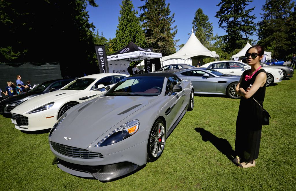 Different types of super cars are seen during the Vancouver luxury and super car show at VanDusen Botanical Garden in Vancouver, Canada, Sept. 5, 2014. ...