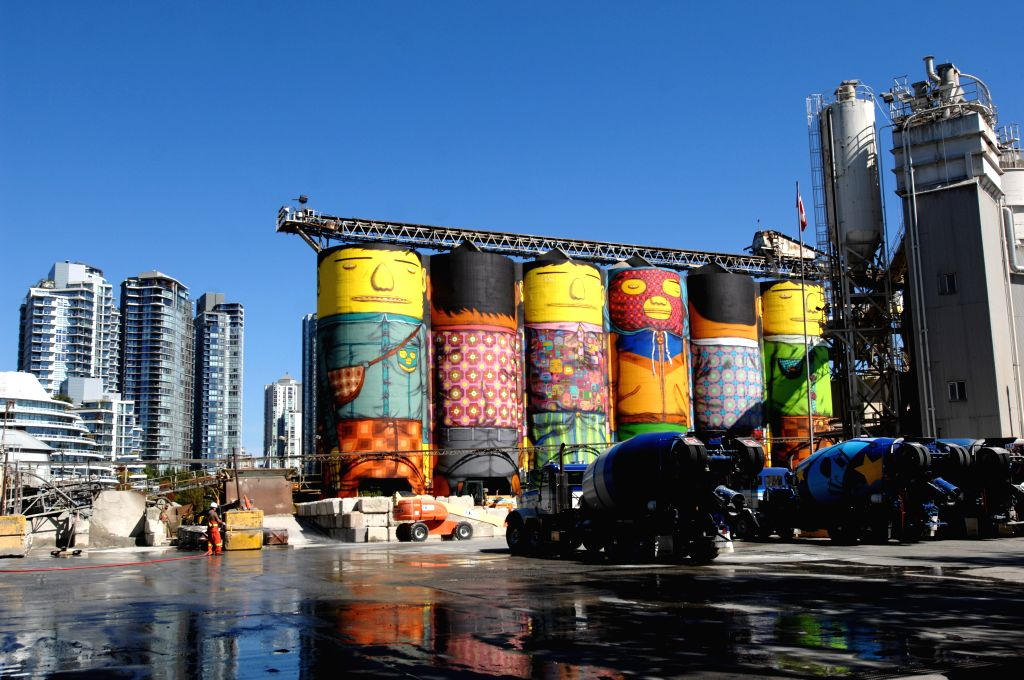 Photo taken on Sept. 5, 2014 shows the urban mural by internationally renowned Brazil artists OSGEMEOS at the Ocean Concrete silos at Granville Island in ...