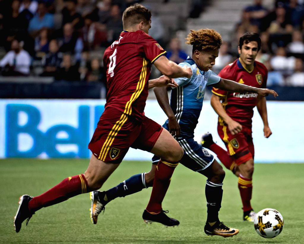 VANCOUVER, Sept. 10, 2017 - Vancouver Whitecaps' Yordy Reyna (C) vies with Real Salt Lake's David Horst (L) during their Major League Soccer match in Vancouver, Canada, on Sept. 9, 2017. Vancouver ...