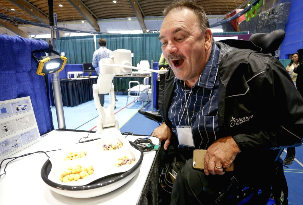 VANCOUVER, Sept. 11, 2018 - A visitor tries an assistive device for eating at the Rehab Equipment Expo 2018 in Vancouver, Canada, Sept. 11, 2018. The Rehab Equipment Expo 2018 was held in Vancouver ...