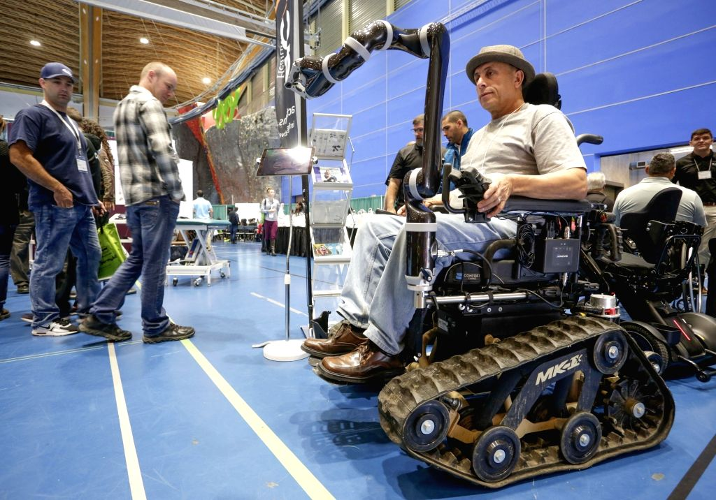 VANCOUVER, Sept. 11, 2018 - A visitor tries an off-road wheelchair equipped with robotic arm at the Rehab Equipment Expo 2018 in Vancouver, Canada, Sept. 11, 2018. The Rehab Equipment Expo 2018 was ...