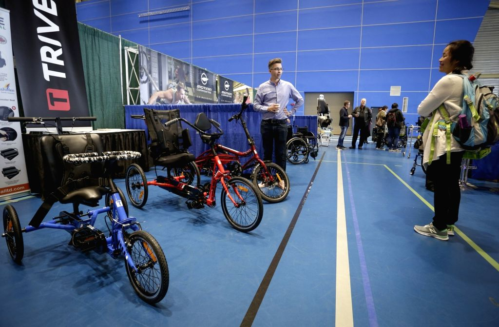 VANCOUVER, Sept. 11, 2018 - Tricycles for disabled people are displayed at the Rehab Equipment Expo 2018 in Vancouver, Canada, Sept. 11, 2018. The Rehab Equipment Expo 2018 was held in Vancouver on ...