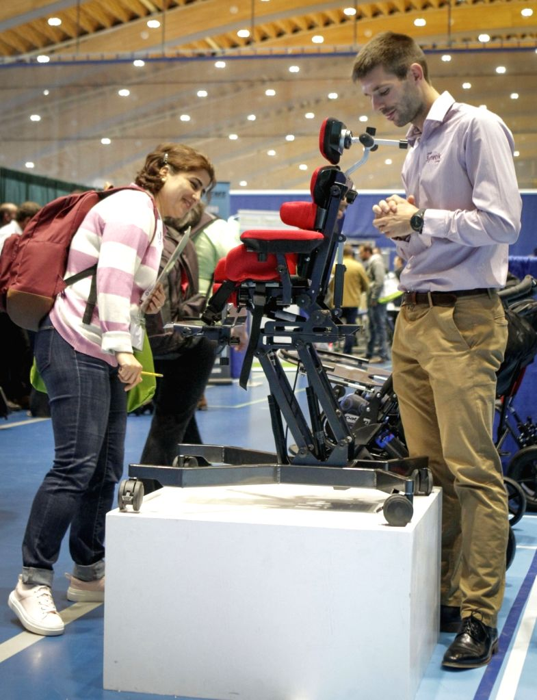 VANCOUVER, Sept. 11, 2018 - Visitors look at a chair for disabled children at the Rehab Equipment Expo 2018 in Vancouver, Canada, Sept. 11, 2018. The Rehab Equipment Expo 2018 was held in Vancouver ...