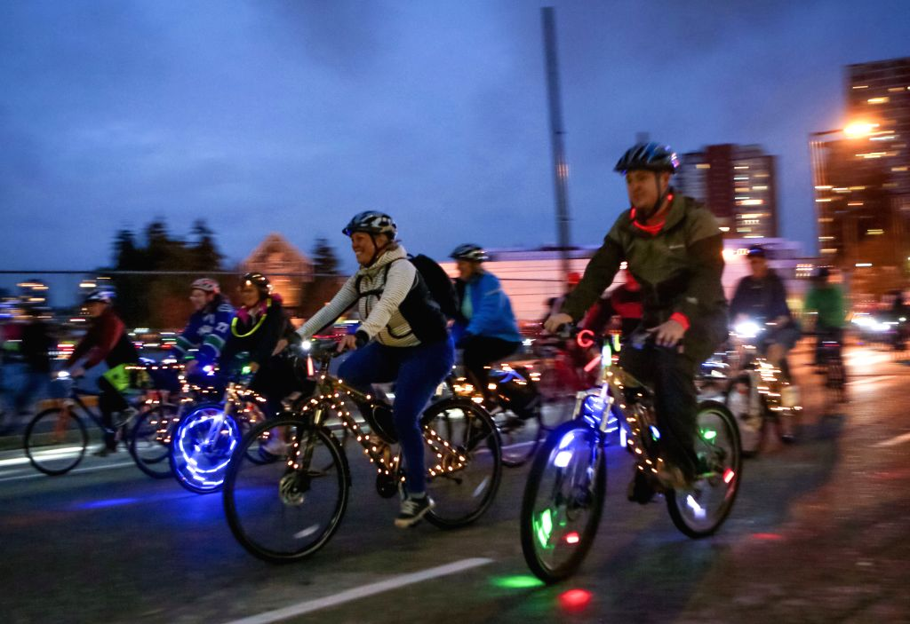 "VANCOUVER, Sept. 16, 2018 - People participate in the third annual ""Bike The Night"" event in Vancouver, Canada, Sept. 15, 2018.About 3,000 people took down the streets in Vancouver's ..."