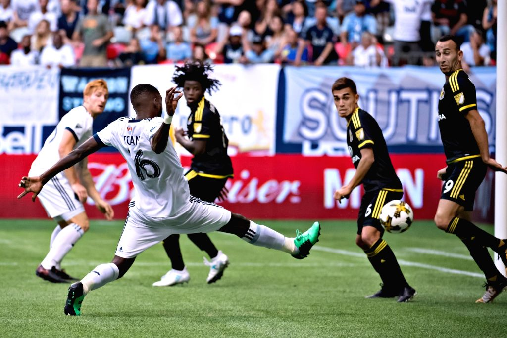 VANCOUVER, Sept. 17, 2017 - Vancouver Whitecaps' Tony Tchani (Front) scores during the regular season of MLS in Vancouver, Canada, on Sept. 16, 2017.