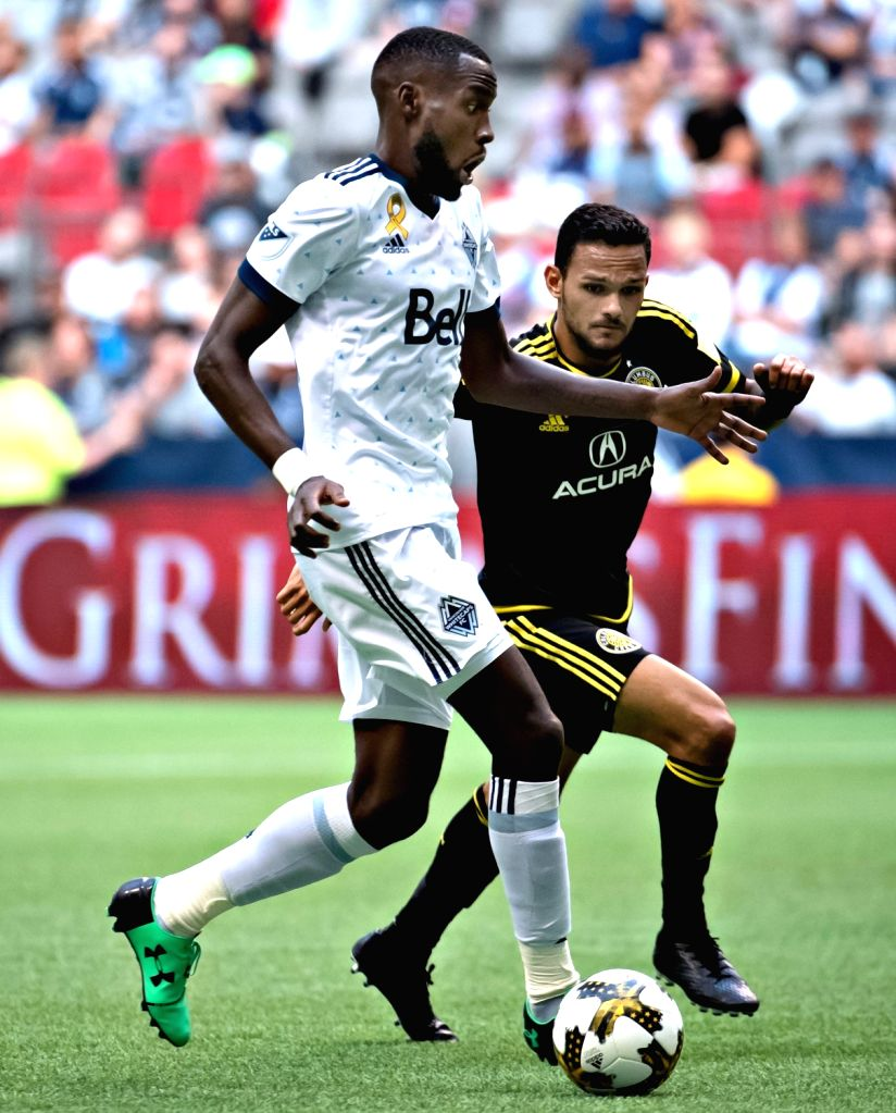 VANCOUVER, Sept. 17, 2017 - Vancouver Whitecaps' Tony Tchani (L) and Artur of Columbus Crew compete for the ball during the regular season of MLS in Vancouver, Canada, on Sept. 16, 2017.