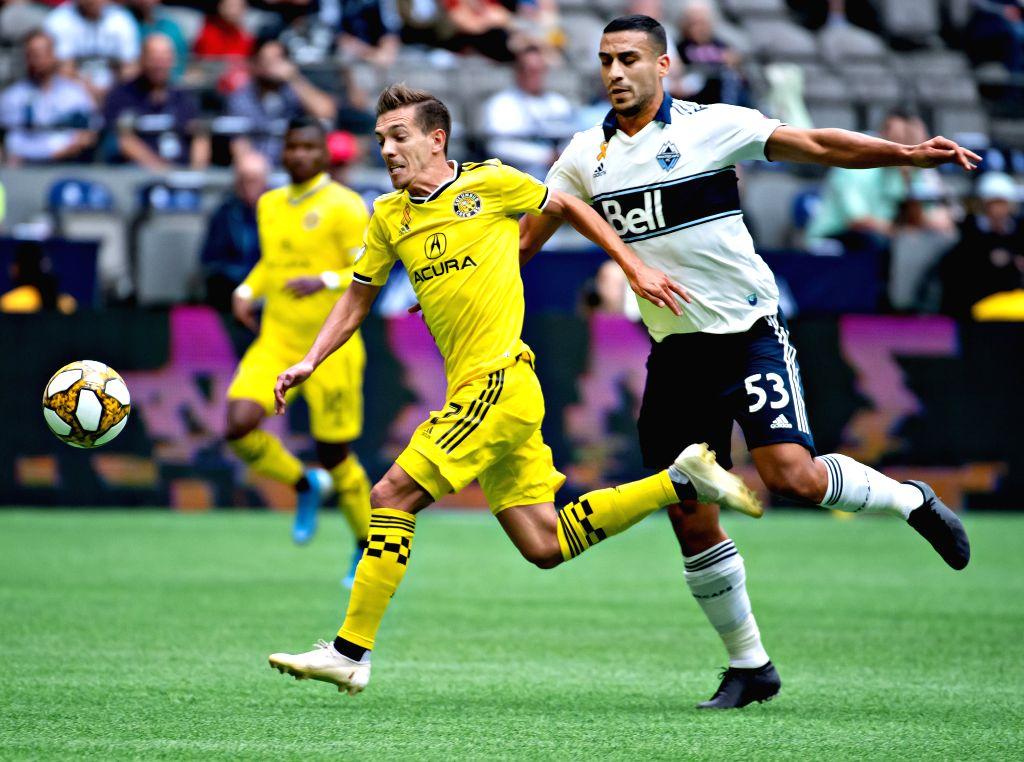 VANCOUVER, Sept. 22, 2019 - Columbus Crew's Pedros Santos (L) vies with Vancouver Whitecaps' Ali Adnan during the MLS regular season soccer match between Vancouver Whitecaps FC and Columbus Crew FC ...