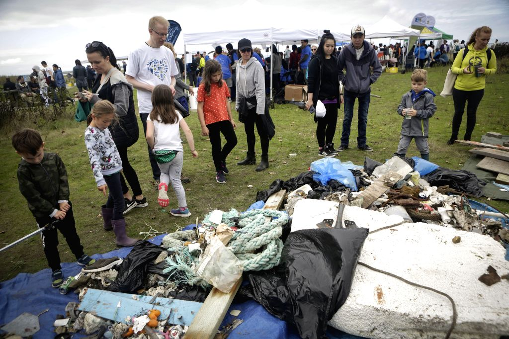 VANCOUVER, Sept. 22, 2019 - People look at the litters collected at the Iona Beach during the annual Great Canadian Shoreline Cleanup event in Vancouver, Canada, Sept. 21, 2019. Tens of thousands ...
