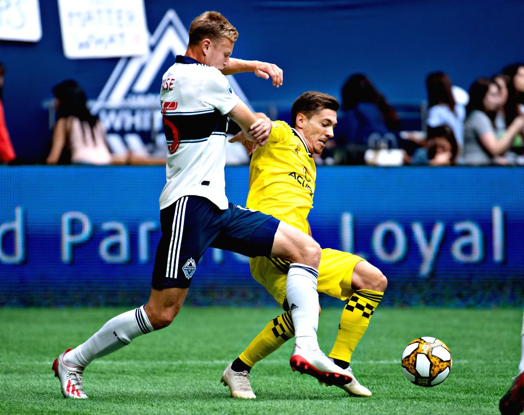 VANCOUVER, Sept. 22, 2019 - Vancouver Whitecaps' Andy Rose (L) vies with Columbus Crew's Pedro Santos during the MLS regular season soccer match between Vancouver Whitecaps FC and Columbus Crew FC in ...