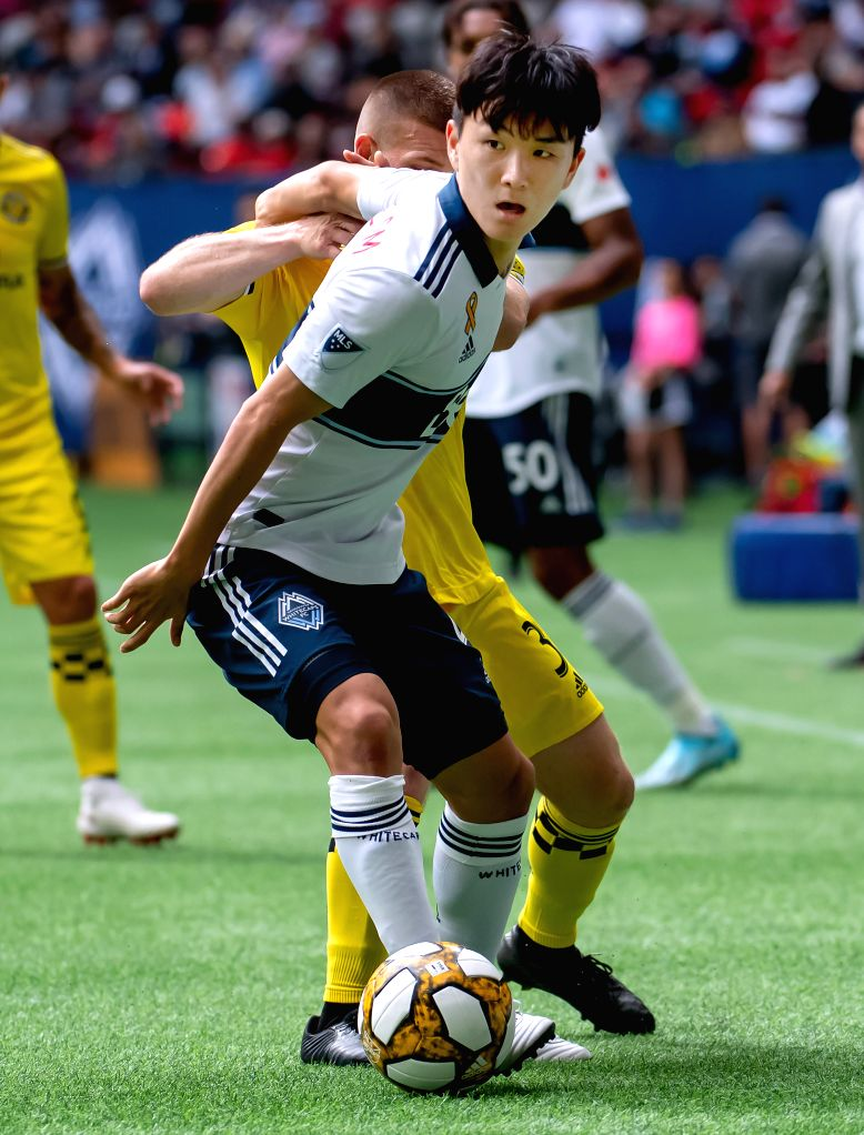 VANCOUVER, Sept. 22, 2019 - Vancouver Whitecaps' Hwang In-Beom (front) vies with Columbus Crew's Connor Maloney during the MLS regular season soccer match between Vancouver Whitecaps FC and Columbus ...