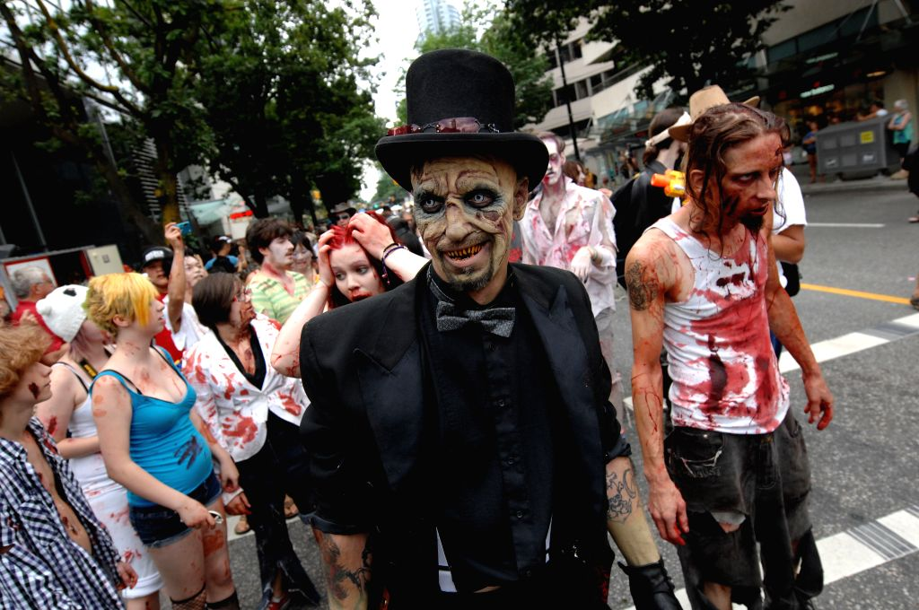 People dressed up as zombies take part in the annual Zombie Walk 2014 in Vancouver, Canada, Sept. 6, 2014. The walk started at the Vancouver Art Gallery and ended