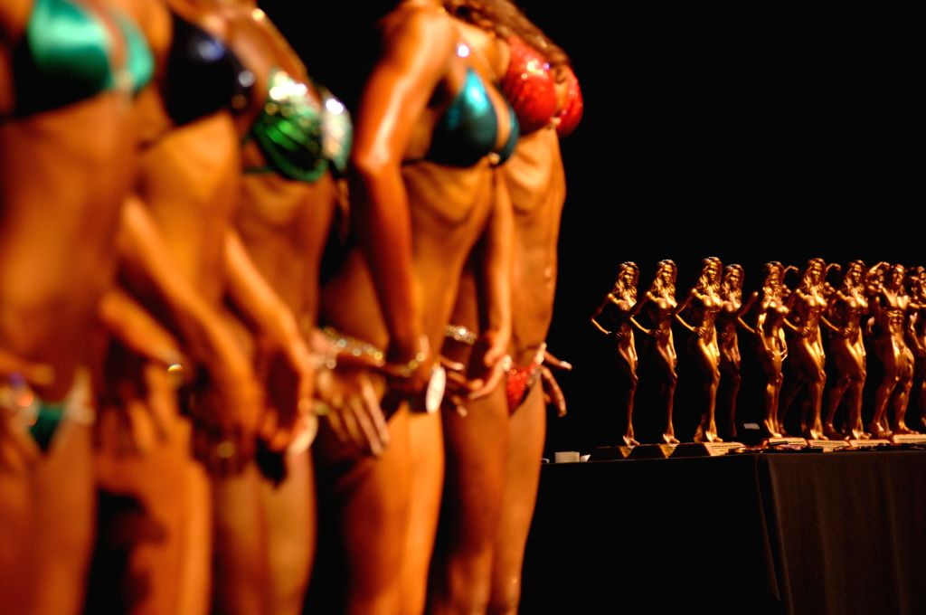 Trophies are lined up to be awarded to winners of each category at the 2014 International Drug Free West Coast Classic Bodybuilding competition in North Vancouver, BC, Canada, Nov. 23, ...