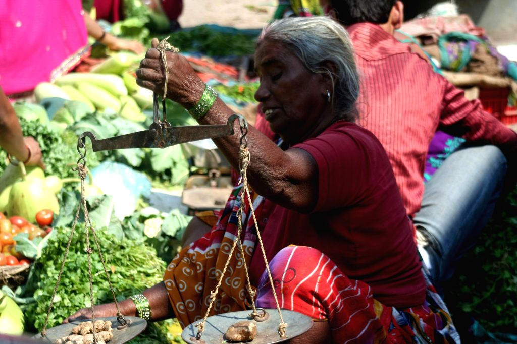 A lady sells vegetables in a Varanasi market on March 8, 2015. International Women's Day is being celebrated across the world.