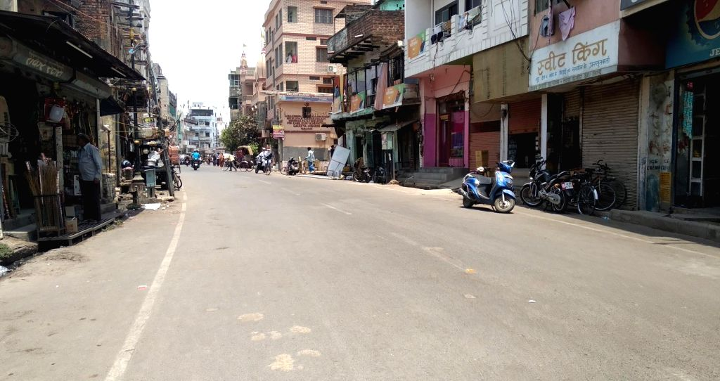 Varanasi: A Varanasi street wears a deserted look as people prefer to stay indoors during the prevailing heatwave conditions in the city with temperature at around 41 degrees, on June 11, 2019. (Photo: IANS)