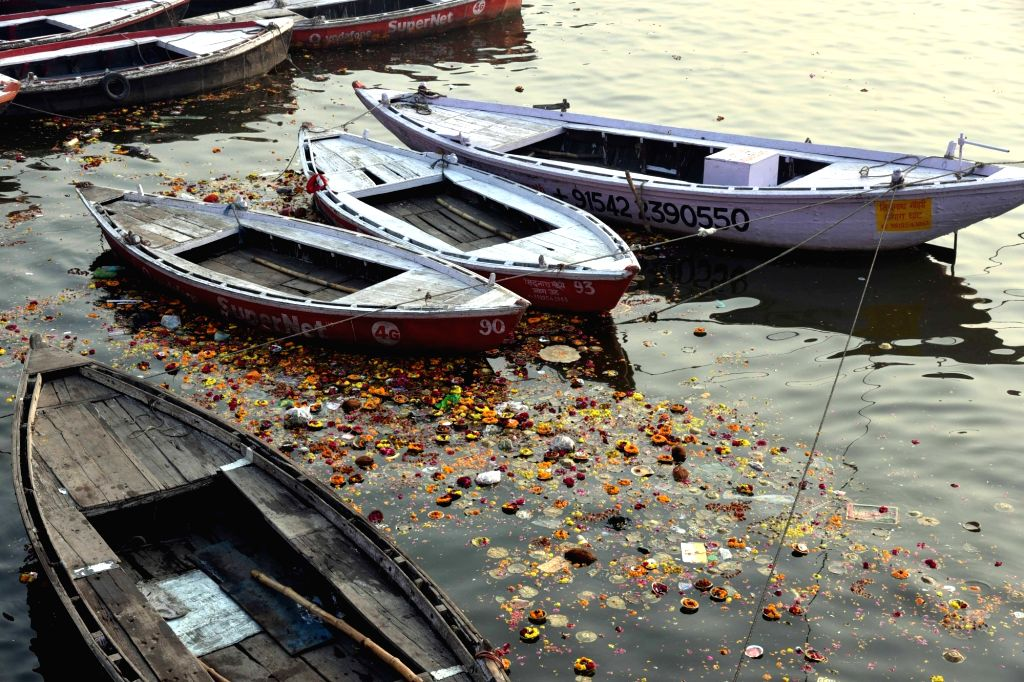 """Varanasi: A view of polluted Ganga river after hundreds of devotees took holy dip in the river and performed rituals on its banks on """"Mauni Amavasya"""" in Varanasi on Feb 4, 2019. (Photo: IANS)"""