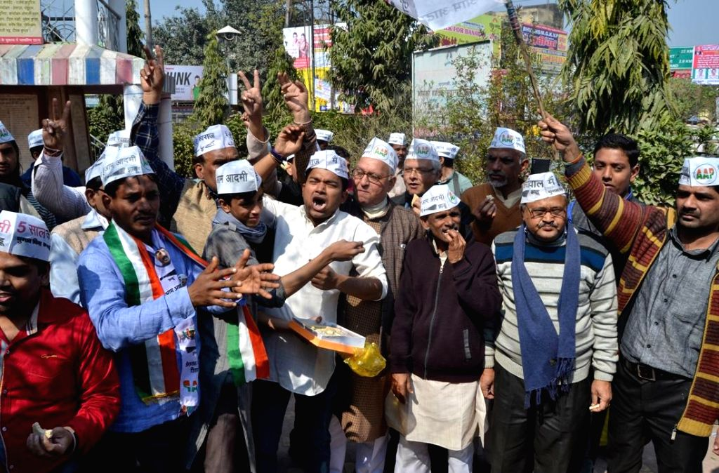 Aam Aadmi Party (AAP) leaders celebrate party's performance in the recently concluded Delhi Assembly Polls in Varanasi, on Feb 10, 2015.