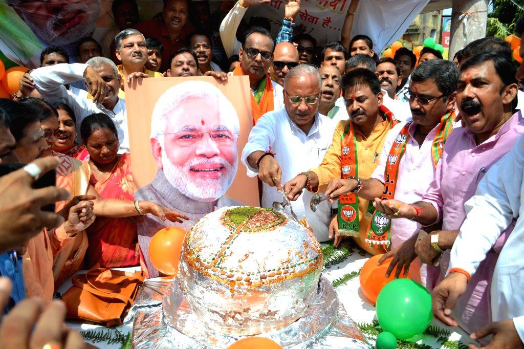 :Varanasi: BJP workers celebrate Prime Minister Narendra Modi's birthday in Varanasi on Sept 17, 2018. (Photo: IANS).