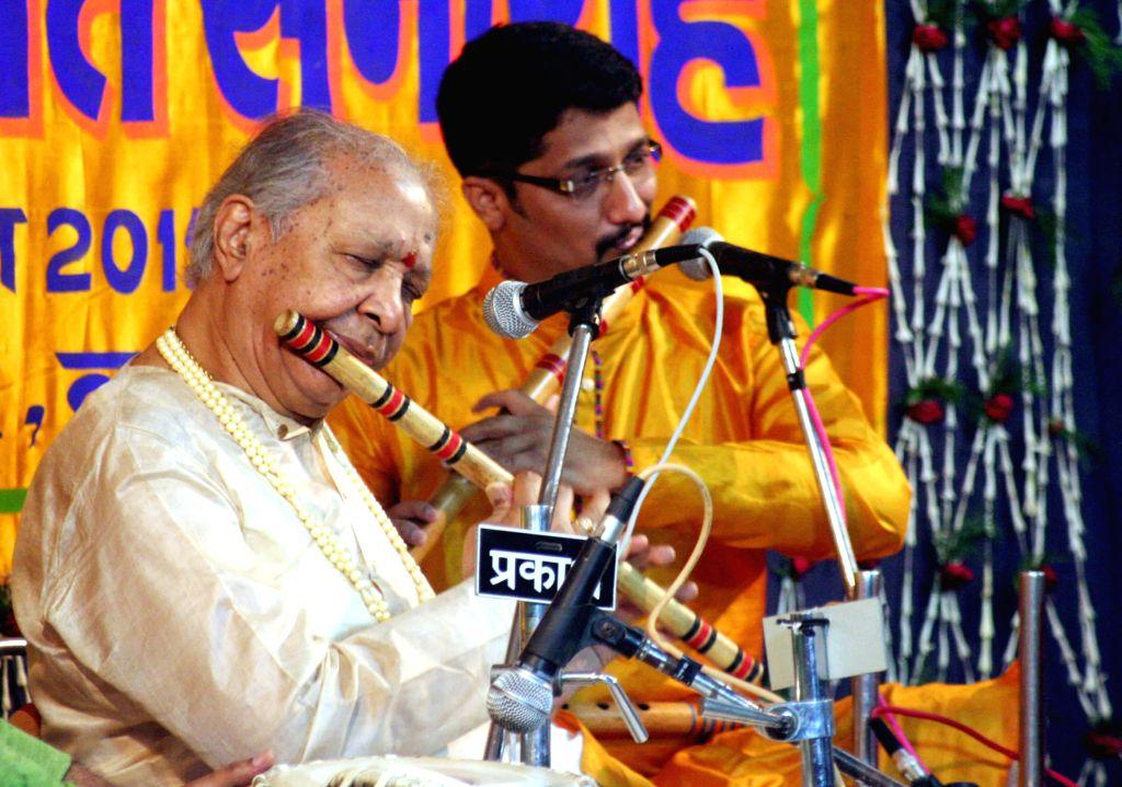Flutist Hariprasad Chaurasia performs during the Sankat Mochan Sangeet Samaroh in Varanasi on April 8, 2015.