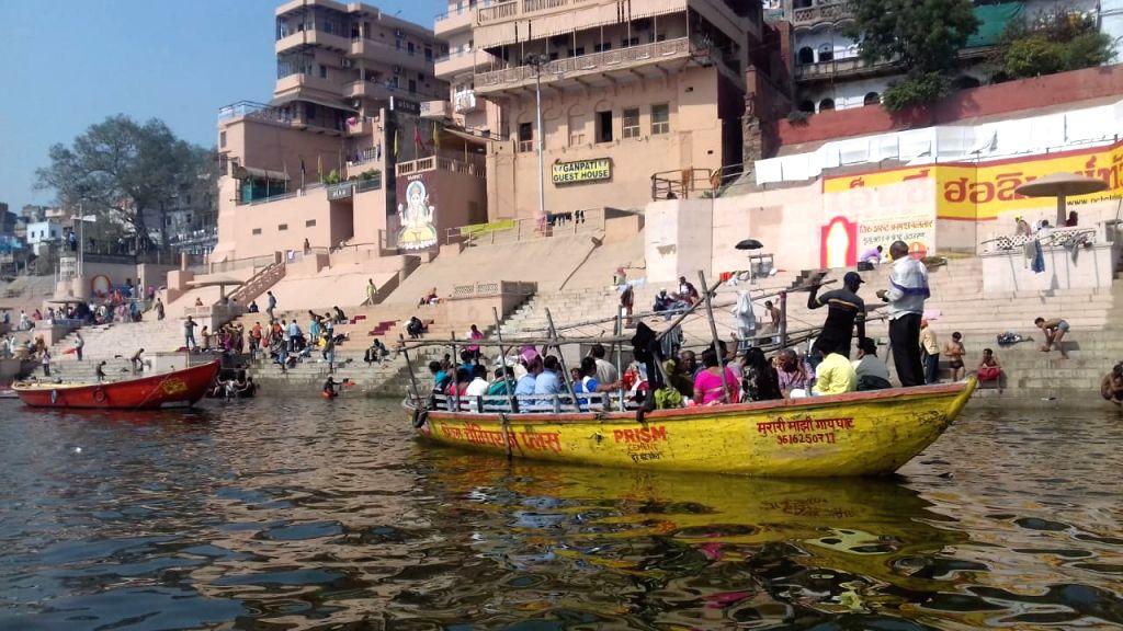 Varanasi: From Benaras to Prayag, it is a Sangam of Faith. People onboard a boat on the Ganga river. (Photo: Richa Sharma/IANS) - Richa Sharma