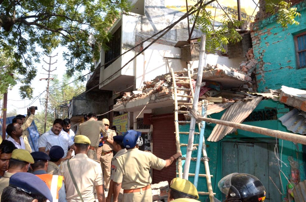 : Varanasi: Police personnel present at the site where an explosion occurred inside a house, reportedly killing one person in Varanasi's Lahartara area on Oct 24, 2018. (Photo: IANS).