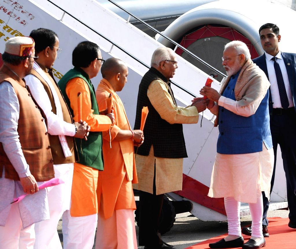 Varanasi: Prime Minister Narendra Modi being welcomed by the Governor of Uttar Pradesh Ram Naik, the Chief Minister of Uttar Pradesh Yogi Adityanath and other dignitaries, on his arrival at Varanasi, Uttar Pradesh on Feb 19, 2019. (Photo: IANS/PIB) - Narendra Modi