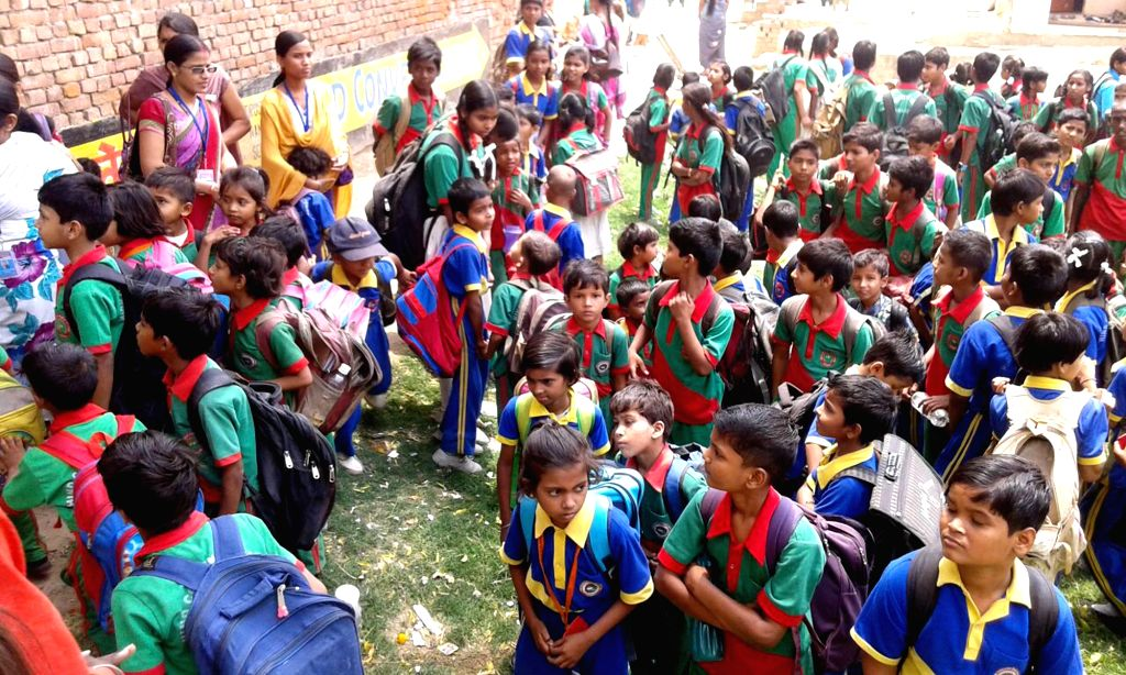 Students evacuated from a Varanasi school as tremors were felt in the city on April 25, 2015. According to the India Meteorological Department, the depth of earthquake was 10 km and ...