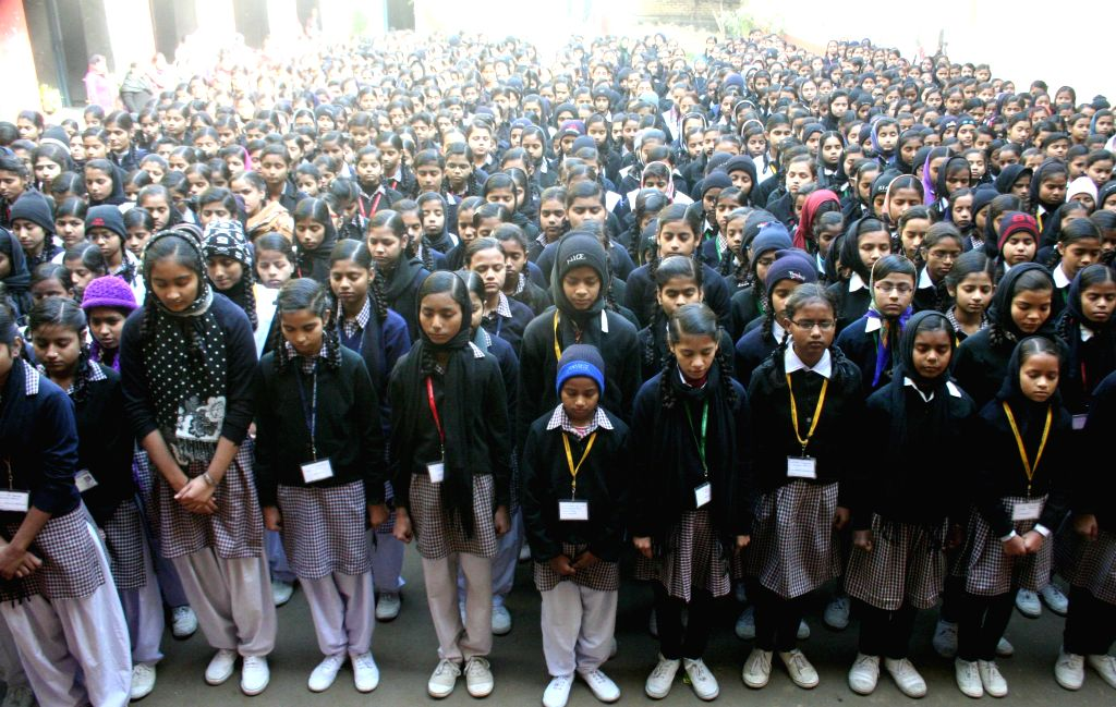 Students participate in a silent protest against Tuesday's attack on the Army Public School in Peshawar, Pakistan, that claimed 104 lives mostly those of children in Varanasi, on Dec 17, ...