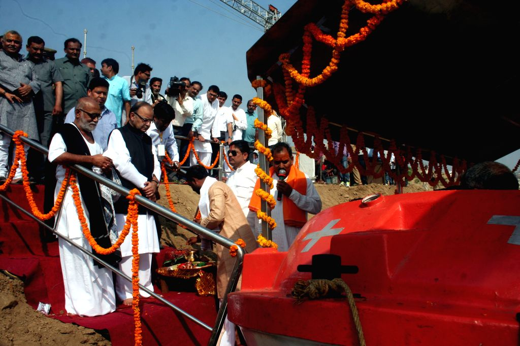 Union Minister for Finance, Corporate Affairs, and Information and Broadcasting Arun Jaitley with spiritual leader Morari Bapu during the inauguration of `Jal Shav Vahini Steamer Boat` at ...